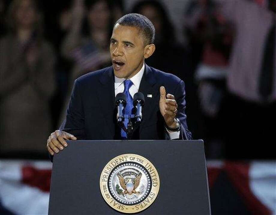 President Barack Obama speaks at his election night party Wednesday in Chicago. Associated Press Photo: AP / AP