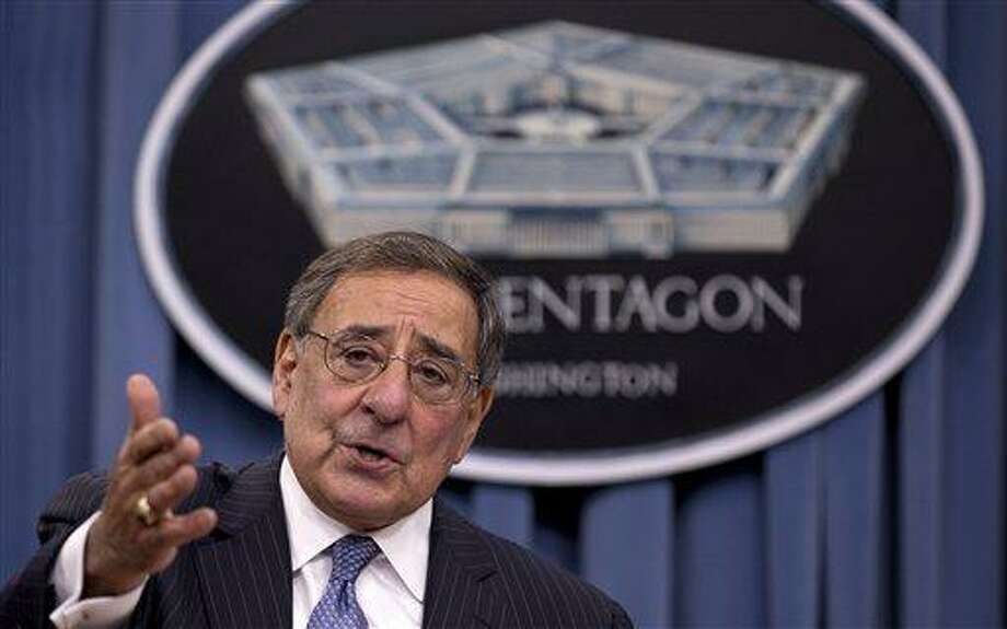 FILE - This Oct. 25, 2012 file photo shows Defense Secretary Leon Panetta gestureing as he speaks during a joint news conference at the Pentagon. New Pentagon details show that the first U.S. military unit arrived in Libya more than 14 hours after the attack on the consulate in Benghazi was over and four Americans, including the ambassador, were dead.  (AP Photo/Carolyn Kaster, File) Photo: AP / AP
