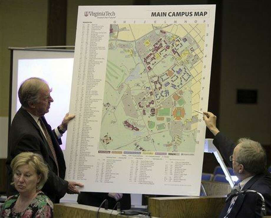 "Defense attorney William ""Bill"" Broaddus, left, holds an enlarged map of the Virginia Tech campus as vice president of student affairs, Ed Spencer, right, comments on it in Montgomery County Circuit Court in Christiansburg, Va., Monday. Spencer was describing walking from his office on campus to a dorm room crime scene the morning of April 16, 2007.   Associated Press Photo: AP / The Roanoke Times"