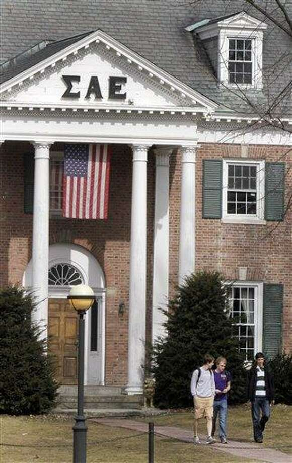 In this photo taken Monday, students leave the Sigma Alpha Epsilon fraternity on the Dartmouth College campus in Hanover, N.H. More than a quarter of the fraternity's membership has been accused by the school's judicial council of hazing after a former member alleged disgusting hazing practices.  Associated Press Photo: AP / AP