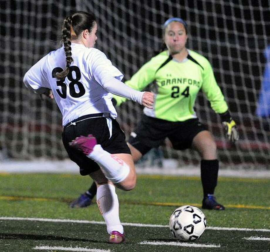 Branford's goalkeeper Rebecca Vitale is about to make the stop on this shot by Shelton's Alexis Zoppi during the first half of Branford's SCC championship from Tuesday night.  Photo--Peter Casolino/New Haven Register.