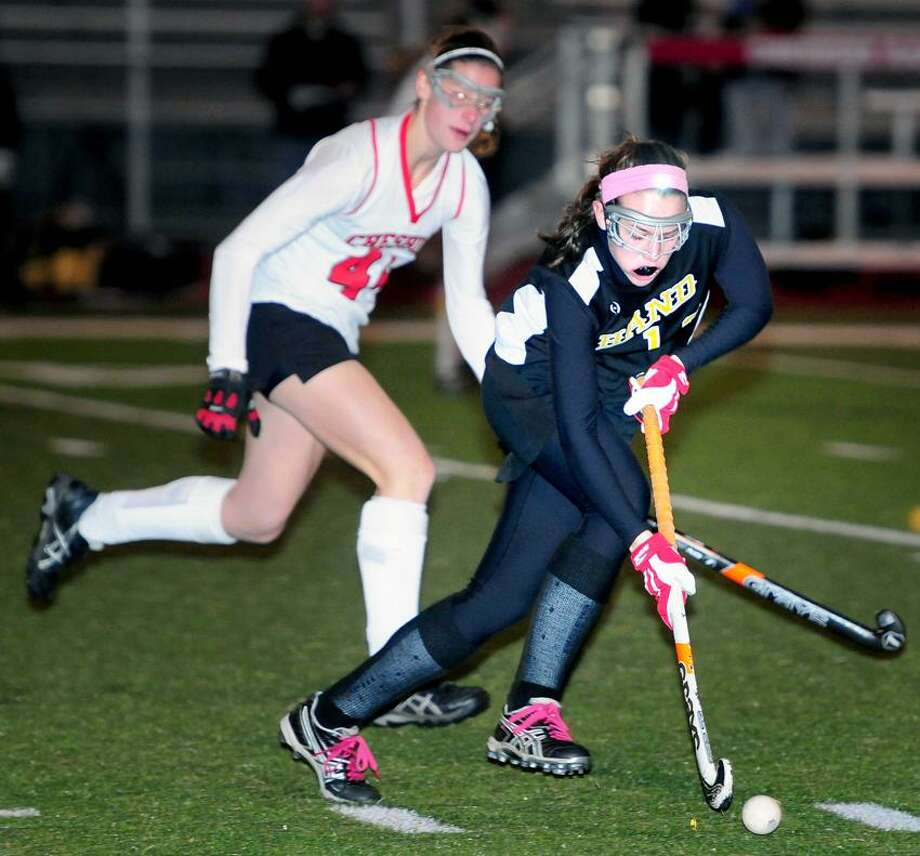 Hand's Brenna Hobin moves the ball up the field with Cheshire's Michelle Federico, close behind during Cheshire's SCC championsjhip win Tuesday night. Photo by Arnold Gold/New Haven Register