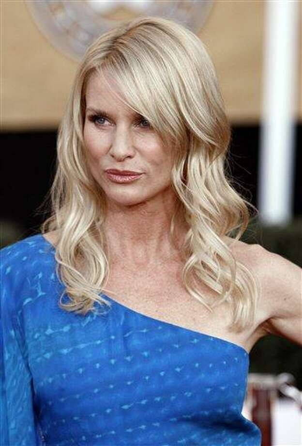 "FILE - This Jan. 25, 2009 file photo shows actress Nicollette Sheridan arriving at the Screen Actors Guild Awards in Los Angeles. The trial over Sheridan's firing from ""Desperate Housewives"" has featured all the elements the show thrived on - personality conflicts, mystery and suspense. Soon it will be Sheridan and the show's creator left eagerly awaiting the outcome as the trial draws to a close and jurors decide whose version of events is more credible. (AP Photo/Matt Sayles, File) Photo: AP / AP2009"