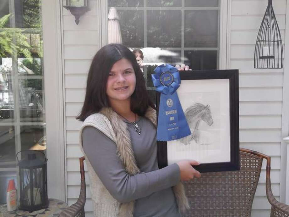 Natalie Garrison, 12, of Torringon holds up her drawing that won first place in the Youth/Junior exhibit at the Bethlehem Fair.