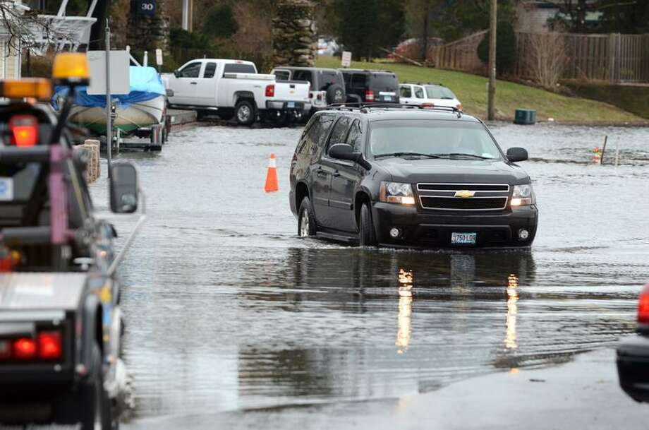 A truck maneuvers through the water at the corner of Thimble Island Rd and Three Elms Rd in Stony Creek in Branford. VM Williams 01.12.2012
