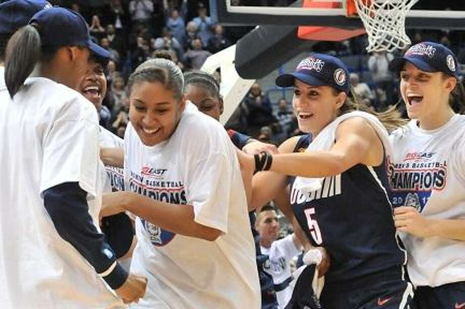 Tuesday March 6, 2012 Hartford, CT. Connecticut Huskies forward Kaleena Mosqueda-Lewis #23 gets harassed by her teammates as she is named Most Outstanding Player in the 2012 Big East Tournament in post game ceremonies of the 2012 Women's Big East Tournament ,Connecticut vs Notre Dame at the XL Center in Hartford, CT. UConn won 63-54, for its fifth consecutive Big East Conference Tournament Championship. Bill Shettle / Cal Sport Media (Cal Sport Media via AP Images) Photo: ASSOCIATED PRESS / AP2012