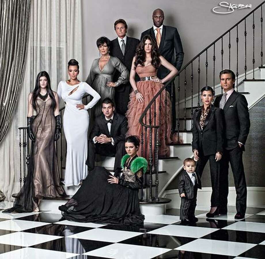 E! photo: Even though Arts Editor Donna Doherty didn't receive their holiday card this year, she still spends her Sunday nights with the Kardashians. Hmm, seems someone's missing from this happy photo. / Nick Saglimbeni / Slickforce Inc.