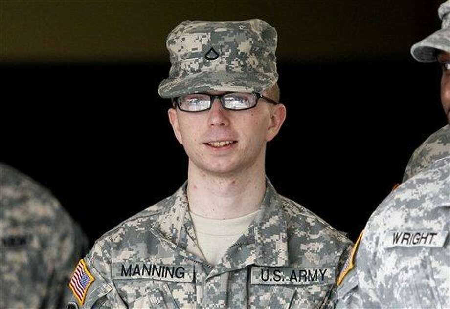 In this photo taken Dec. 22, 2011, Army Pfc. Bradley Manning is escorted from a courthouse in Fort Meade, Md. An Army officer is recommending a general court-martial for Manning, a low-ranking intelligence analyst charged in the biggest leak of classified information in U.S. history.  (AP Photo/Patrick Semansky) Photo: AP / AP