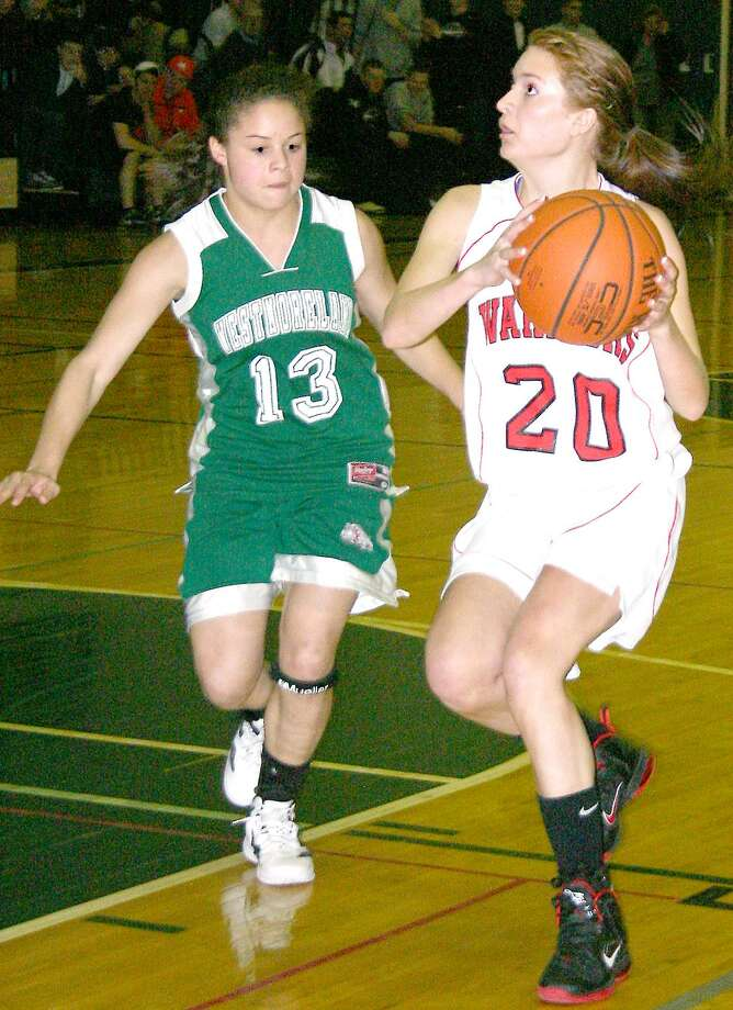 Submitted Photo by JON RATHBUN  Morrisville-Eaton's Sarah Crowell dribbles the ball as Westmoreland's Skylar Zawko defends in the Center State Conferenece's Exceptional Seniors game played in Herkimer. Crowell finished with three points.