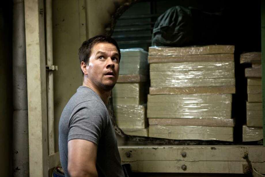 "Patti Perret/Universal Pictures: Mark Wahlberg has one last job to do in ""Contraband."" Photo: AP / Copyright: © 2012 Universal Studios. ALL RIGHTS RESERVED. Copyright: © 2012 Universal Studios. ALL RIGHTS RESERVED."