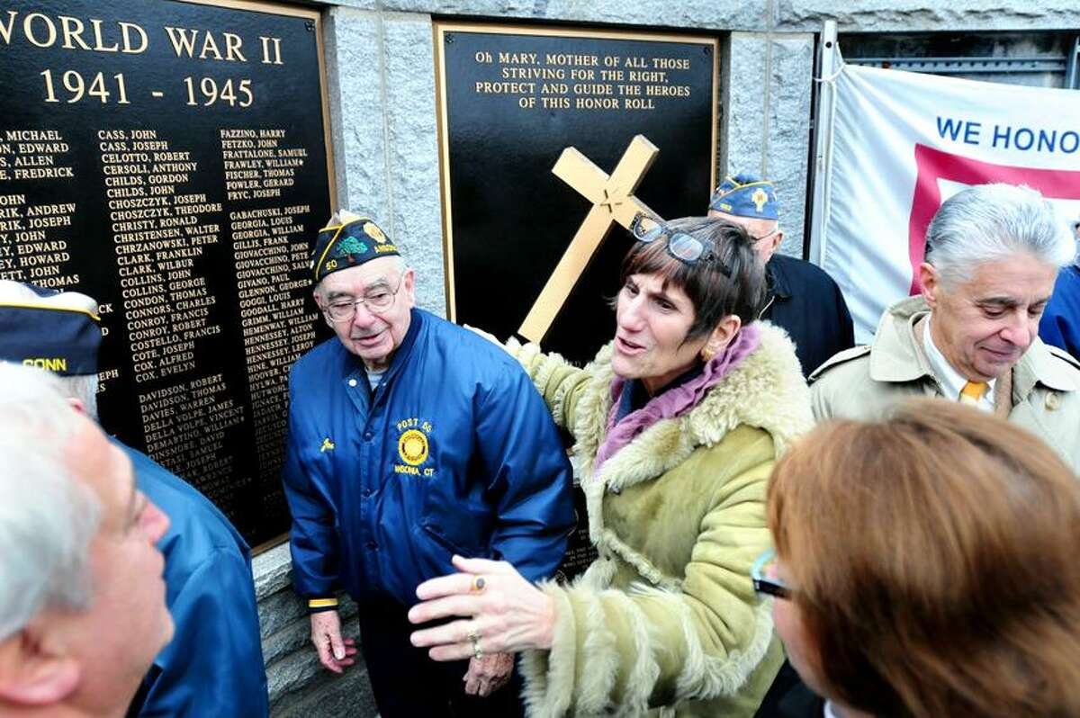 U.S. Rep. Rosa DeLauro, D-3, talks with Derby Mayor Anthony Staffieri, bottom left, Joseph Berube Sr., center left, and state Rep. Linda Gentile, bottom right, after a press conference announcing the Protect Veterans' Memorials Act at the Woodbridge Avenue Honor Roll and War Memorial in Ansonia Thursday. At far right is Jamie Cohen, president of the Valley Community Foundation, who announced the Veterans Memorial Plaques Restoration Fund. Arnold Gold/Register