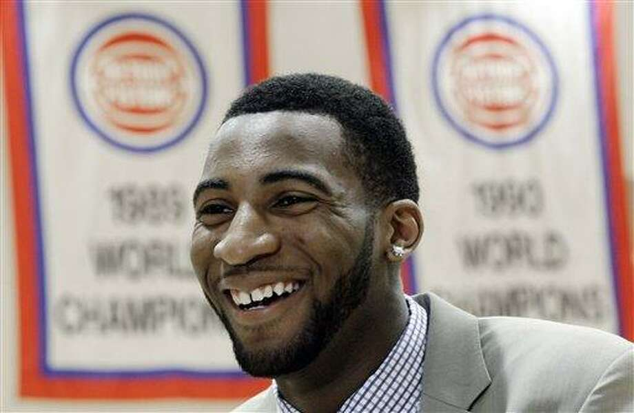 Detroit Pistons first-round draft choice Andre Drummond smiles after being introduced to the media at an NBA basketball news conference in Auburn Hills, Mich., Friday, June 29, 2012.  (AP Photo/Paul Sancya) Photo: AP / AP