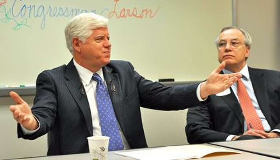 U.S. Representative John Larson (D-1) talks with members of the Northwest Connecticut's Chamber of Commerce during Friday morning's business round table discussion. Attorney Bill Riiska, right, served as moderator for the event.