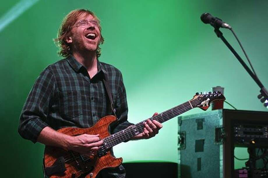 Trey Anastasio of Phish grins to a packed SPAC Friday evening. Photo Eric Jenks 7/6/12 / Eric Jenks 2011