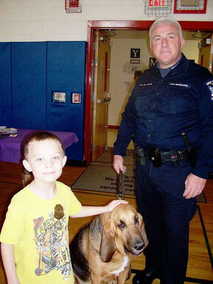 Photo Courtesy TRI-VALLEY YMCA Children had a chance to meet with a police bloodhound during the annual Healthy Kids Day at the Tri-Valley YMCA, as well as learn more about how the Y is fighting to keep kids safe.