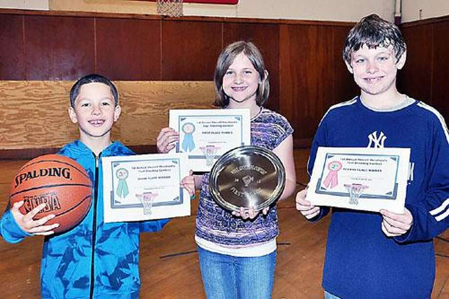 Photo Courtesy SHERRILL CAC The Sherrill Merchants Association family fun day on Sunday April 22 featured a foul-shooting contest. First place shooter was McKenzie Finn, center. At left is third place shooter Caleb Randel-Spells, and second place went to Jack Adams.