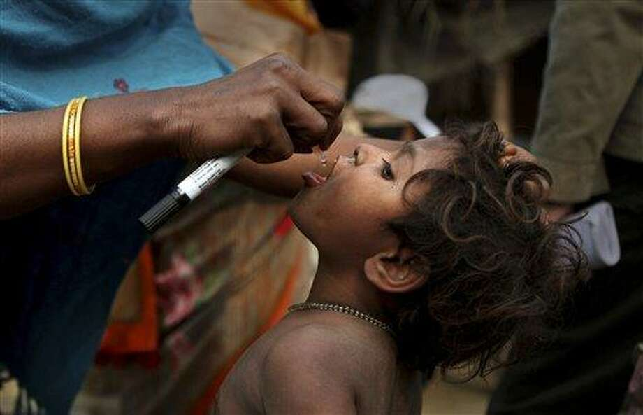 In this January 2011 photograph, Sanjana Shoba, a polio vaccinator, administers vaccine to a child in Tilkeshwar village, some 200 kilometers from Patna, India. India will celebrate a full year since its last reported case of polio on Friday.  Associated Press Photo: AP / AP