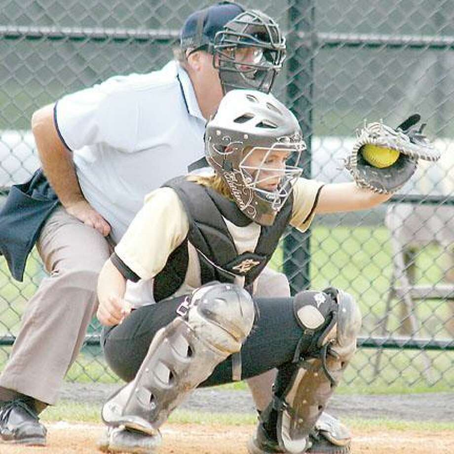 Photo Courtesy JON RATHBUN Herkimer County Community College catcher Cheyenne Bumpus receives a pitch. Bumpus was an All-Conference First Team selection this season.
