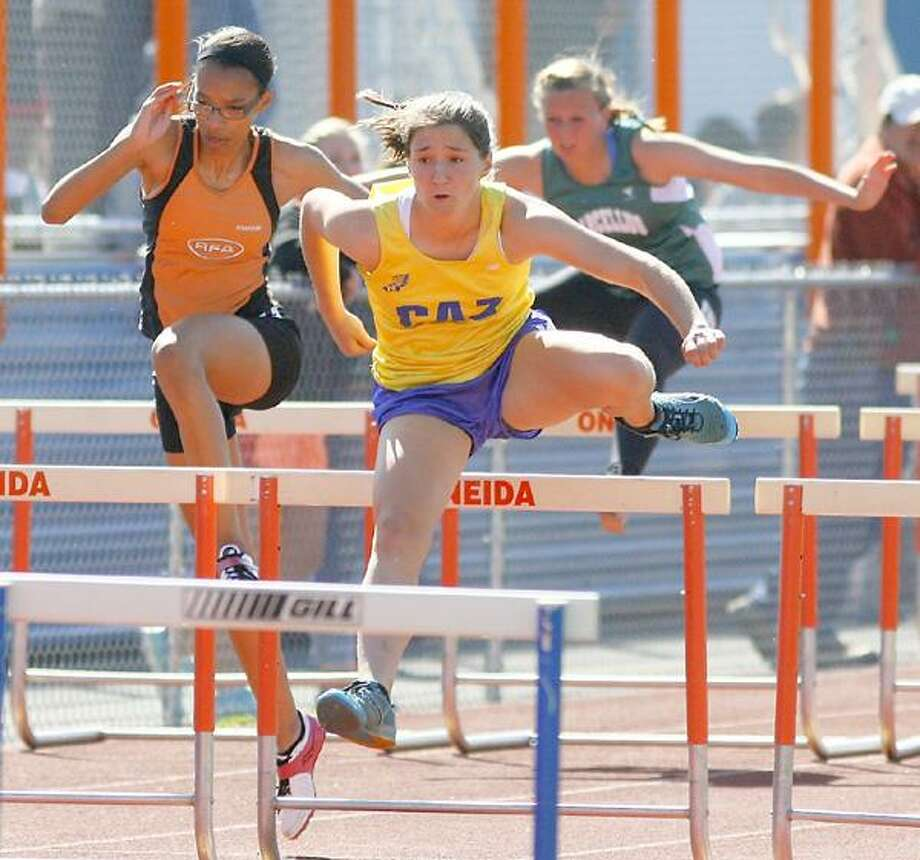 "Dispatch Staff Photo by JOHN HAEGER <a href=""http://twitter.com/oneidaphoto"">twitter.com/oneidaphoto</a>Cazenovia's Paige Biviano pulls ahead of the field during a 100 meter hurdles heat on Friday, May 10, 2012 at the Oneida Invational. Biviano won the heat but finished second in the event overall."