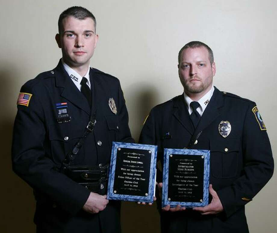 "Dispatch Staff Photo by JOHN HAEGER <a href=""http://twitter.com/oneidaphoto"">twitter.com/oneidaphoto</a> Officer Steve Lowell and Inv. Mike Burgess named Oneida Ciry Police Officers of the Year during the annual Oneida's Club Charlie Decker Public Safety Dinner   on Friday, May 10, 2012 in the city of Oneida"