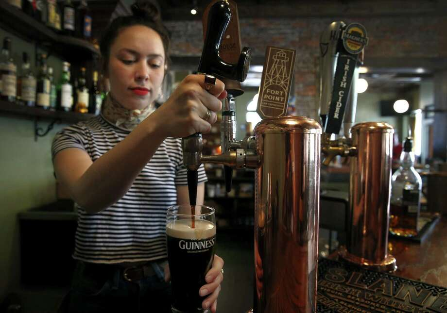 Bartender Blake Cole pours a pint of Guinness on July 22, 2017, at Sláinte, a new Irish pub in Oakland, Calif. Diageo reported a 1 percent increase in Guinness sales in North America for the 12-month period ending June 30, 2017, with the liquor giant having its North American headquarters in Norwalk, Conn. Photo: Paul Chinn / The Chronicle / ONLINE_YES
