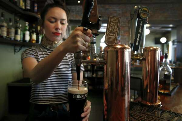 Bartender Blake Cole pours a pint of Guinness on July 22, 2017, at Sláinte, a new Irish pub in Oakland, Calif. Diageo reported a 1 percent increase in Guinness sales in North America for the 12-month period ending June 30, 2017, with the liquor giant having its North American headquarters in Norwalk, Conn.