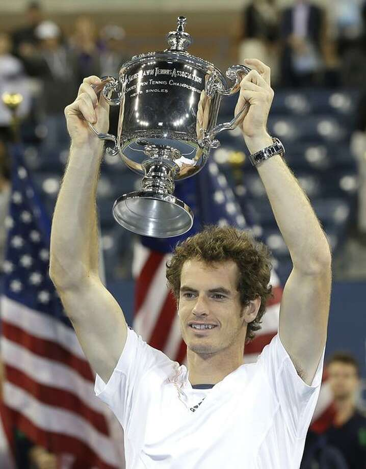 Britain's Andy Murray poses with the trophy after beating Serbia's Novak Djokovic in the championship match at the 2012 US Open tennis tournament, Monday, Sept. 10, 2012, in New York. (AP Photo/Mike Groll) Photo: AP / AP