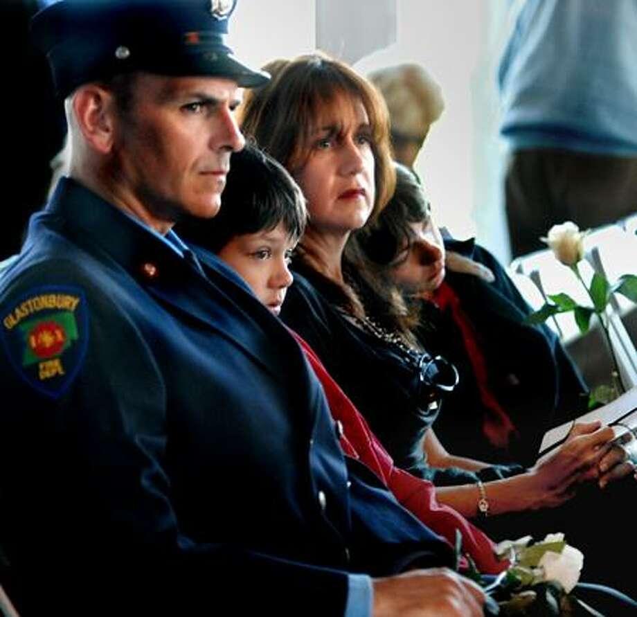 Left to Right: Martin, Tyler,9, Jeanine, and Ryan,13, Van Riper, of Glastonbury. Jeanine's mother, Barbara Bradshaw was killed in the World Trade Center bombing 9/11/01.   Melanie Stengel/Register