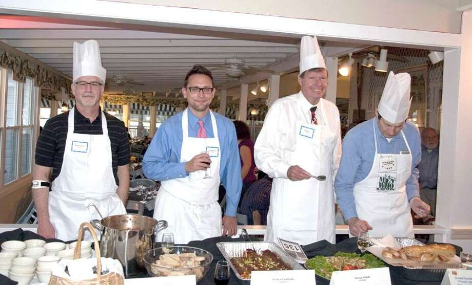 Women and Family Life Center photo: In a previous edition of Men Who Cook, chefs Barry Felson, left, Craig Becker, State Sen. Ed Meyer and Donald Baechler stepped up to the plate.