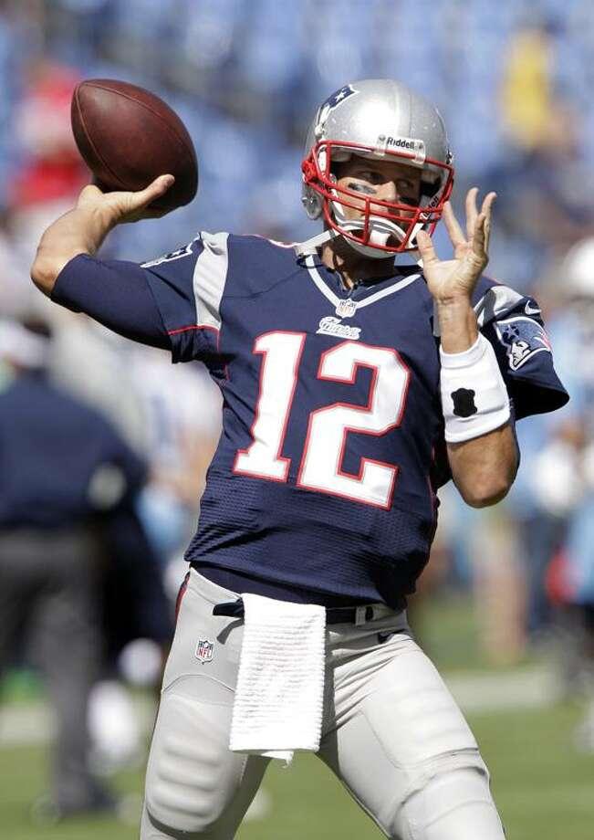 New England Patriots quarterback Tom Brady warms up before an NFL football game between the Tennessee Titans and the New England Patriots on Sunday, Sept. 9, 2012, in Nashville, Tenn. (AP Photo/Wade Payne) Photo: AP / AP2012