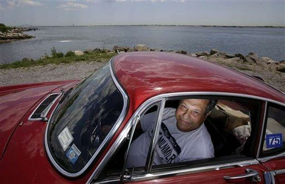 Irv Gordon poses for a picture July 2 in his Volvo P1800 in Babylon, N.Y. Gordon's car already holds the world record for the highest recorded mileage on a car and he is less than 40,000 miles away from passing three million miles on the Volvo. Associated Press Photo: AP / AP