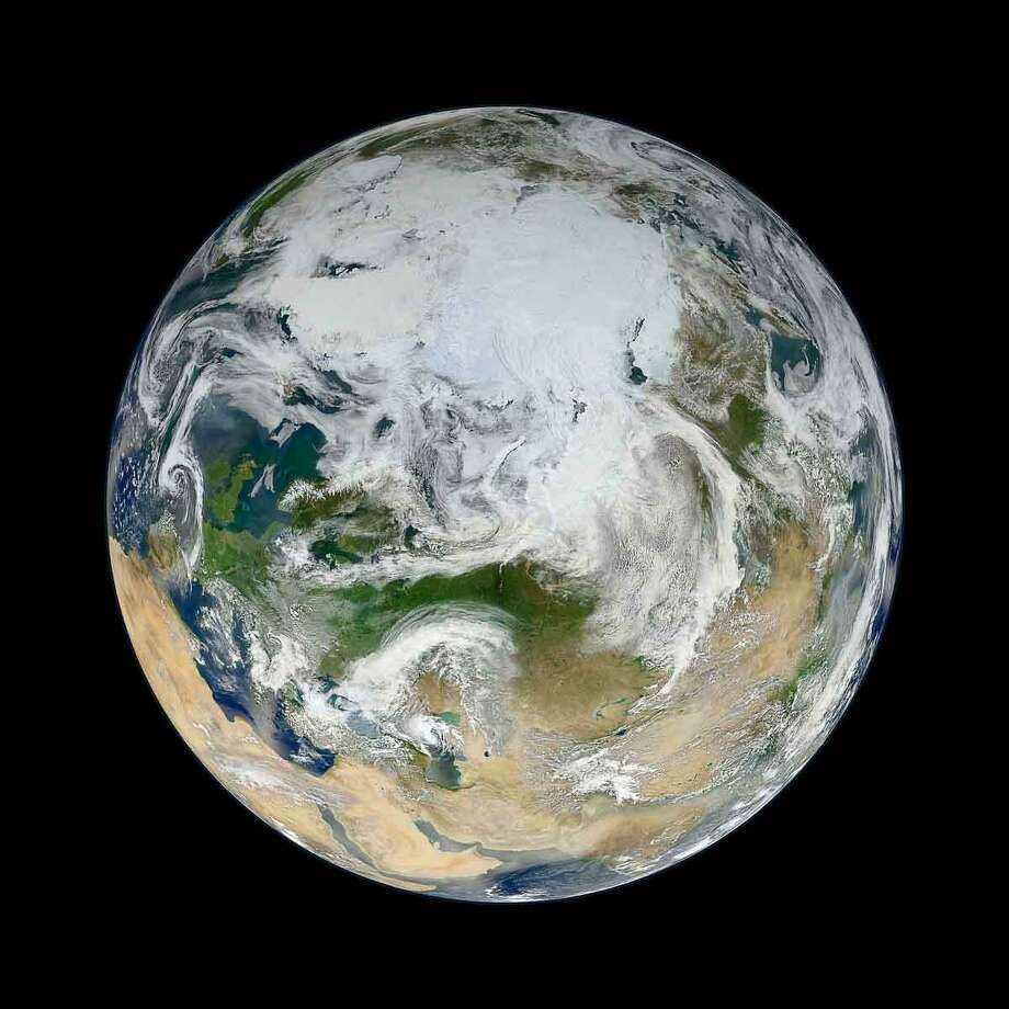 Ocean scientist Norman Kuring of NASA's Goddard Space Flight Center pieced together this composite image of Europe, Asia, North Africa, and the entire Arctic. It was compiled from 15 satellite passes made by Suomi-NPP on May 26, 2012. The spacecraft circles the Earth from pole to pole at an altitude of 824 kilometers (512 miles), so it takes multiple passes to gather enough data to show an entire hemisphere without gaps in the view.Kuring stitched the image swaths together and then set up this view looking down from 70 degrees North, 60 degrees East. (That is, the view is artificial, as the satellite does not see the full disc at one time.) He was able to show the Arctic in this image because northern hemisphere spring spreads enough sunlight over the North Pole to allow a natural-light view.