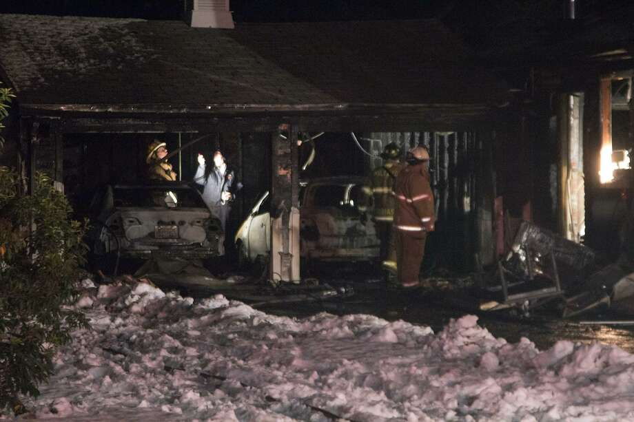 A fire on 39 Tippy Road damaged the residents' two cars, garage and part of their house Thursday night. No one was hurt in the incident. Photo by Rich Scinto
