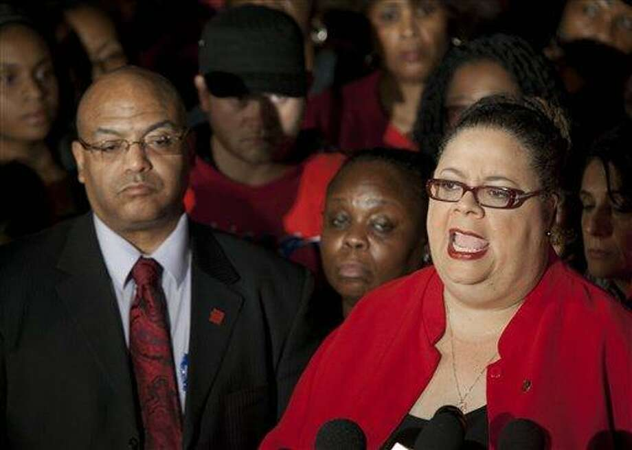 Chicago Teachers Union President Karen Lewis, right, tells reporters at a news conference outside the union's headquarters that the city's 25,000 public school teachers will walk the picket line Monday morning after final-day talks with the Chicago Board of Education failed to reach an agreement over teachers' contracts on Sunday in Chicago. Associated Press Photo: AP / AP