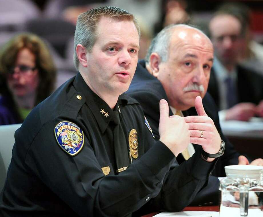 Police chiefs Matt Reed, left, of South Windsor and Anthony Salvatore, right, of Cromwell speak at a Judiciary Committee hearing concerning updating the Alvin W. Penn Racial Profiling Prohibition Act at the Legislative Office Building in Hartford. Arnold Gold/Register