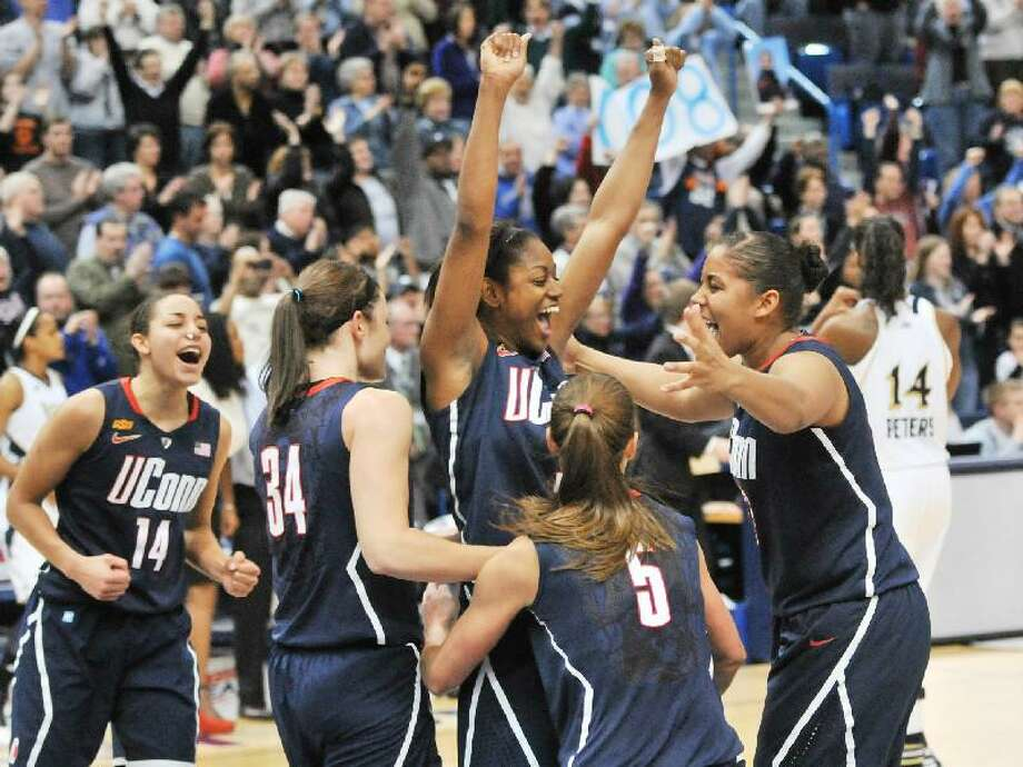 ASSOCIATED PRESS  Connecticut Huskies guard Tiffany Hayes is surrounded by teammates Kaleena Mosqueda-Lewis, Caroline Doty, Kelly Faris, with Bria Hartley, as they celebrated a 63-54 win over Notre Dame on March 6 in the Big East Tournament Championship game at the XL Center in Hartford. The Huskies are the No. 1 seed in the Kingston (R.I.) Region and will play No. 16 Prairie View (17-15) in the first round on Saturday at 1:30 p.m. at the Webster Bank Arena in Bridgeport.
