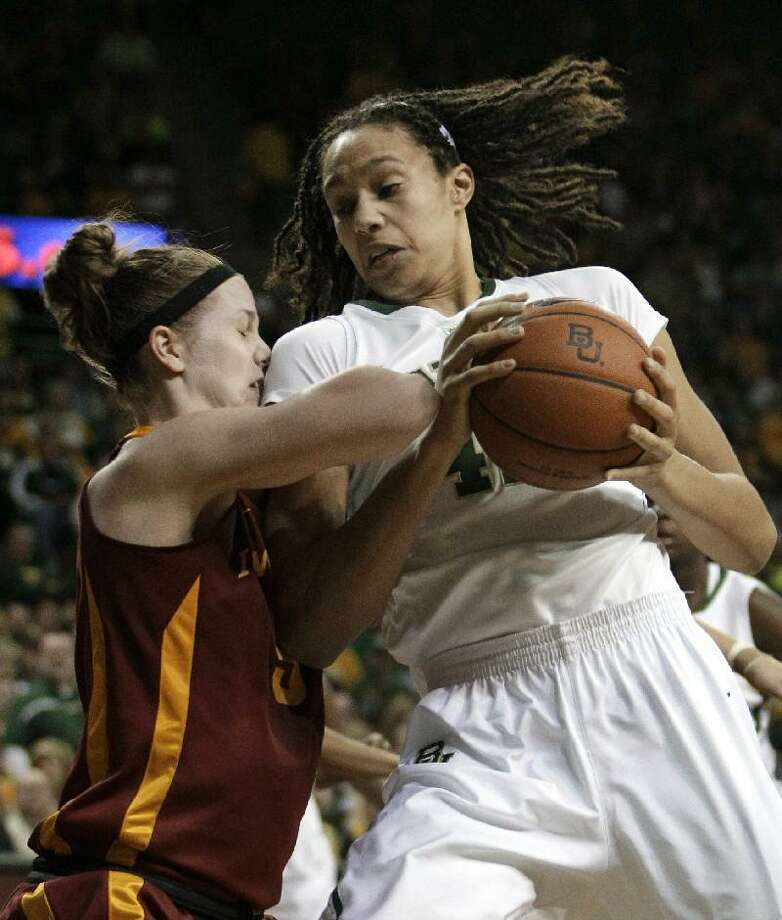 ASSOCIATED PRESS In this March 3 file photo, Baylor's Brittney Griner, right, drives against Iowa State guard Lauren Mansfield during a game in Waco, Texas. Baylor (34-0), which could become the NCAA's first 40-win team if it win its second national title, opens against Big West Conference tournament champion UC-Santa Barbara (17-15) in the NCAA tournament.