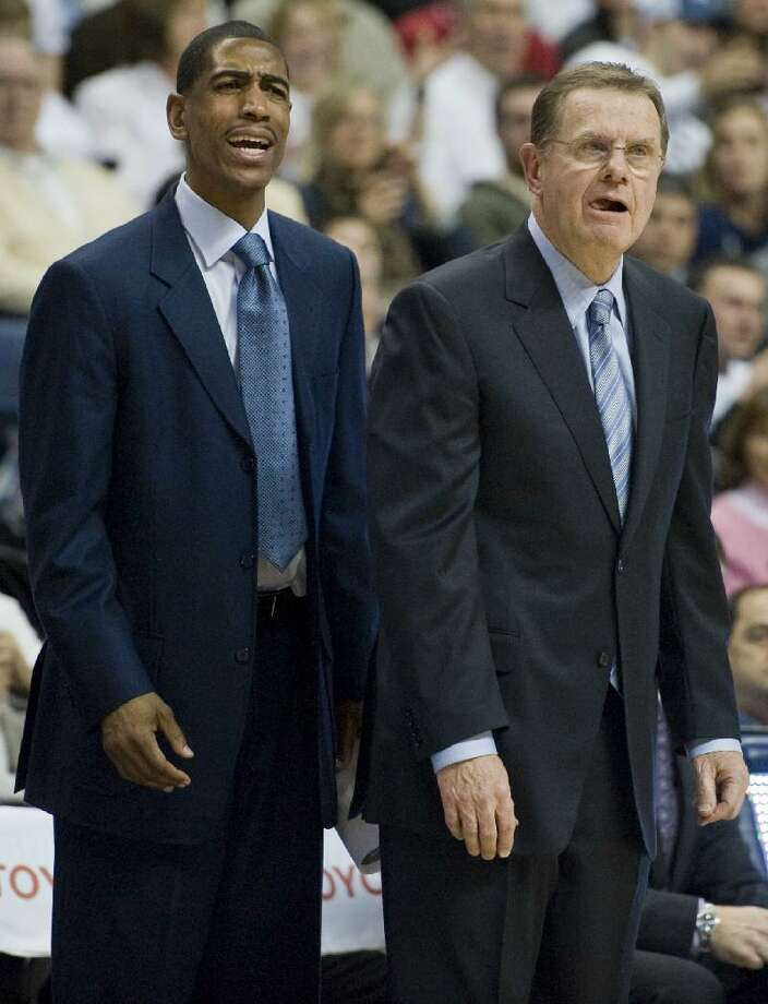 ASSOCIATED PRESS Connecticut assistant coach Kevin Ollie, left, is shown next to associate head coach George Blaney during a Feb. 25 game against Syracuse at Gampel Pavilion in Storrs. Once Arizona recruits, Kevin Ollie and Fred Hoiberg will meet again when UConn plays Iowa State.
