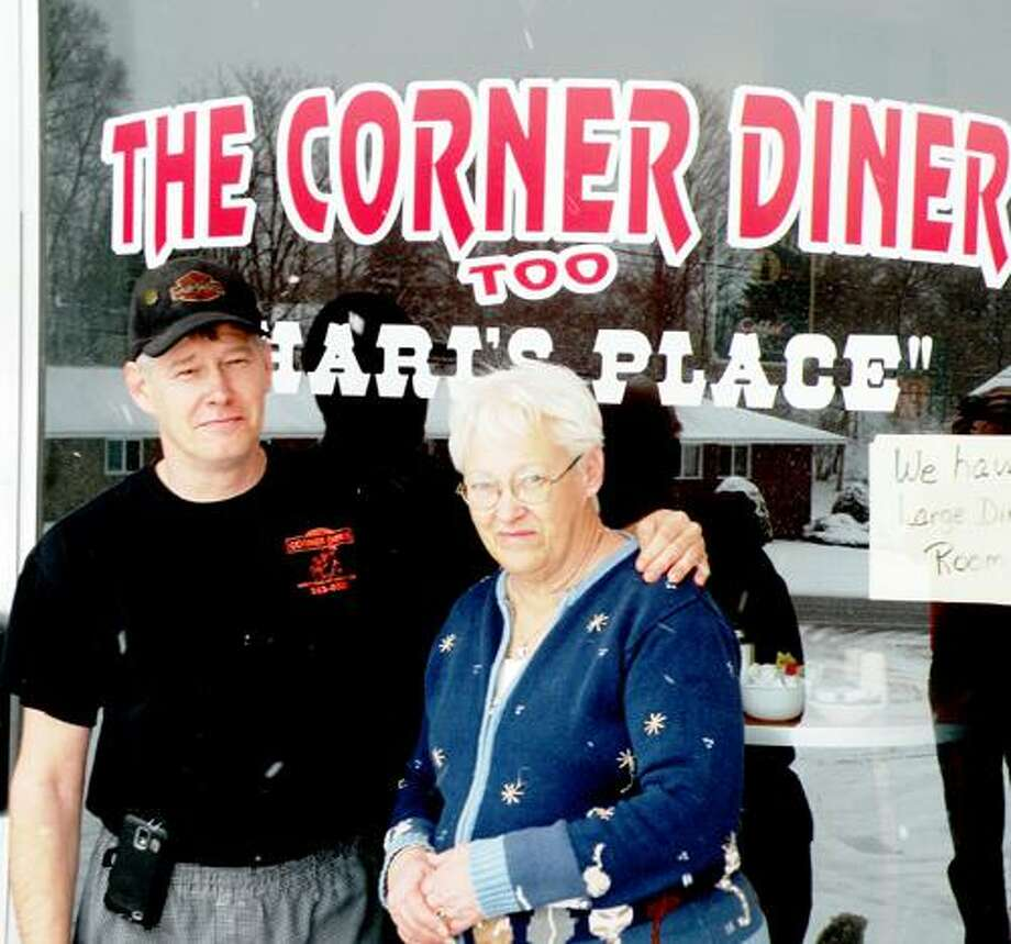 """Photo Special to the Dispatch by MICHAEL YEOMAN Jon LaBuz and his mother, Shari LaBuz, take a breather from serving customers at Jon's new restaurant, The Corner Diner Too """"Shari's Place"""" located on Route 5 in Sherrill."""