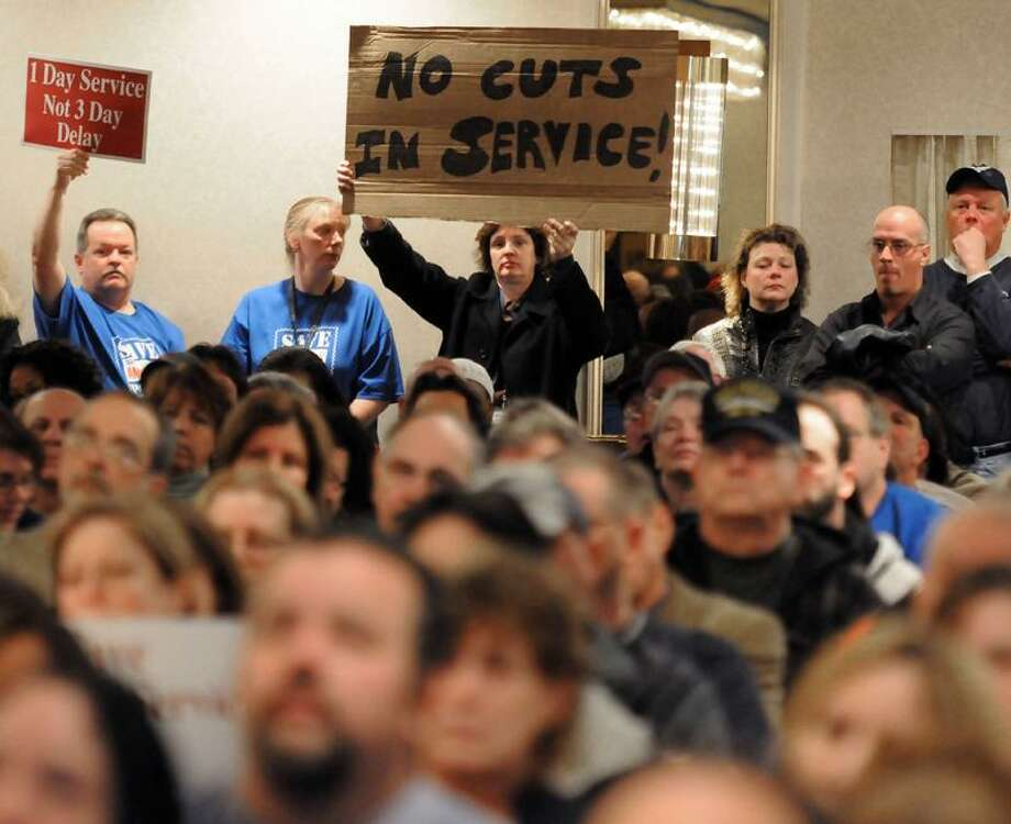 About 400 people, including Cheryl Dziurgot of Northford, came out to a presentation made by the USPS about closing the Southern Connecticut Distribution and Processing Center in Wallingford. Mara Lavitt/Register