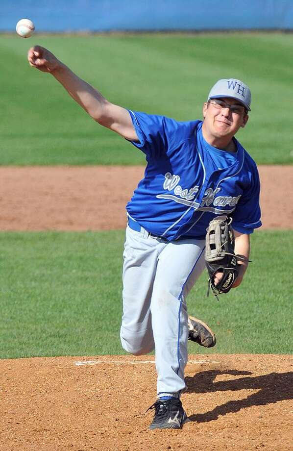 West Haven--West Haven pitcher John Carrano delivers during the 4th inning against Fairfield Prep. .  Peter Casolino/New Haven Register 05/10/12