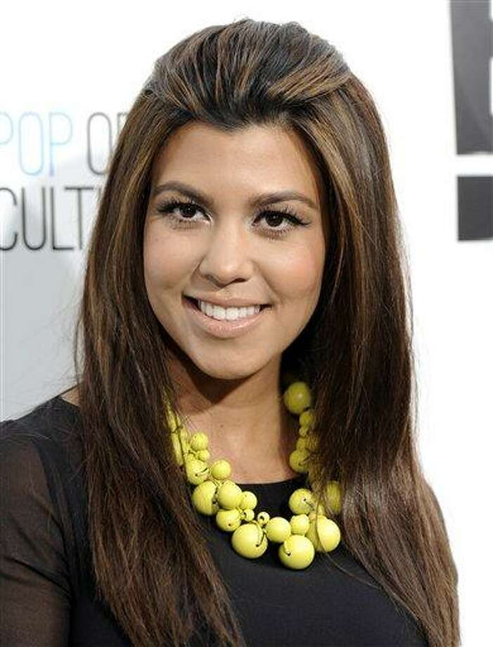 In an April 30, 2012 file photo Kourtney Kardashian  attends an E! Network upfront event at Gotham Hall in New York.  Kourtney Kardashian gave birth to a girl and she's naming  Penelope early Sunday July 8, 2012 at Cedars-Sinai Medical Center in Los Angeles Photo: ASSOCIATED PRESS / A2012