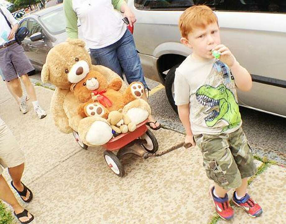 "Dispatch Staff Photo by JOHN HAEGER <a href=""http://twitter.com/oneidaphoto"">twitter.com/oneidaphoto</a> Jonathan Sweet 4, of Canastota makes his way along the parade route with his teddy bears as he takes part in the annual Teddy Bear Parade in Cazenovia on Saturday, July 7, 2012."