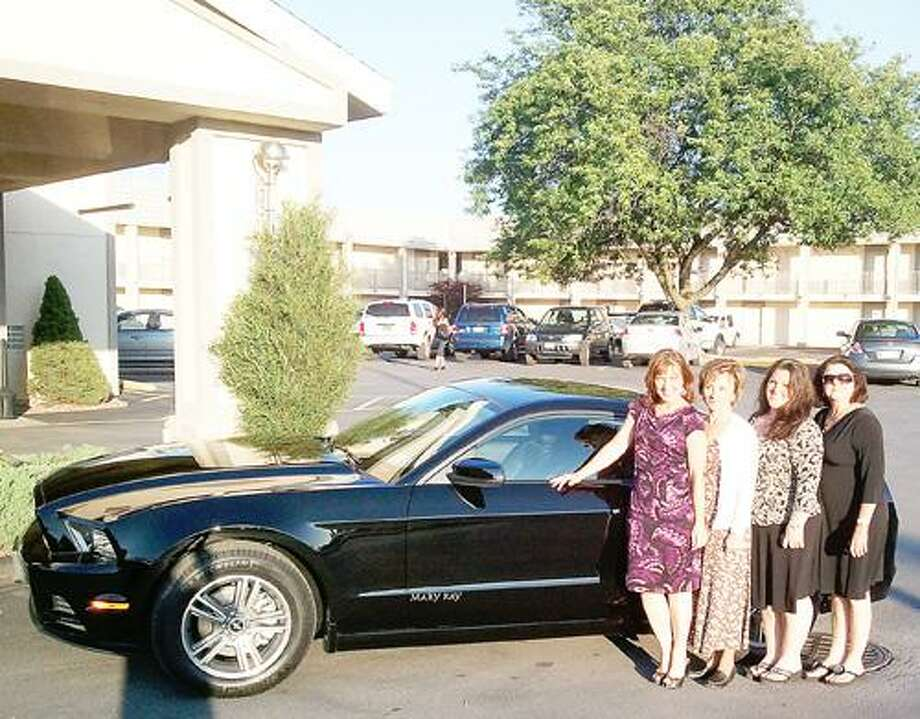 Photo Courtesy MARY KAY Sherry McDonald of Oneida has earned a car in recognition of her sales record with Mary Kay.
