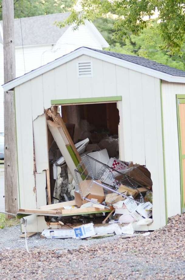 Photo by KYLE MENNIG A storage shed at Christopher's Pizza in Oneida on Monday, July 9, 2012.