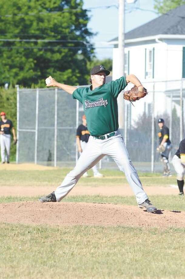 Dispatch Staff Photo by Kyle Mennig Sherrill's Oliver Pratt delivers a pitch during Monday's game against Geneva. Pratt tossed 6 2/3 innings in his team's 4-3 victory.