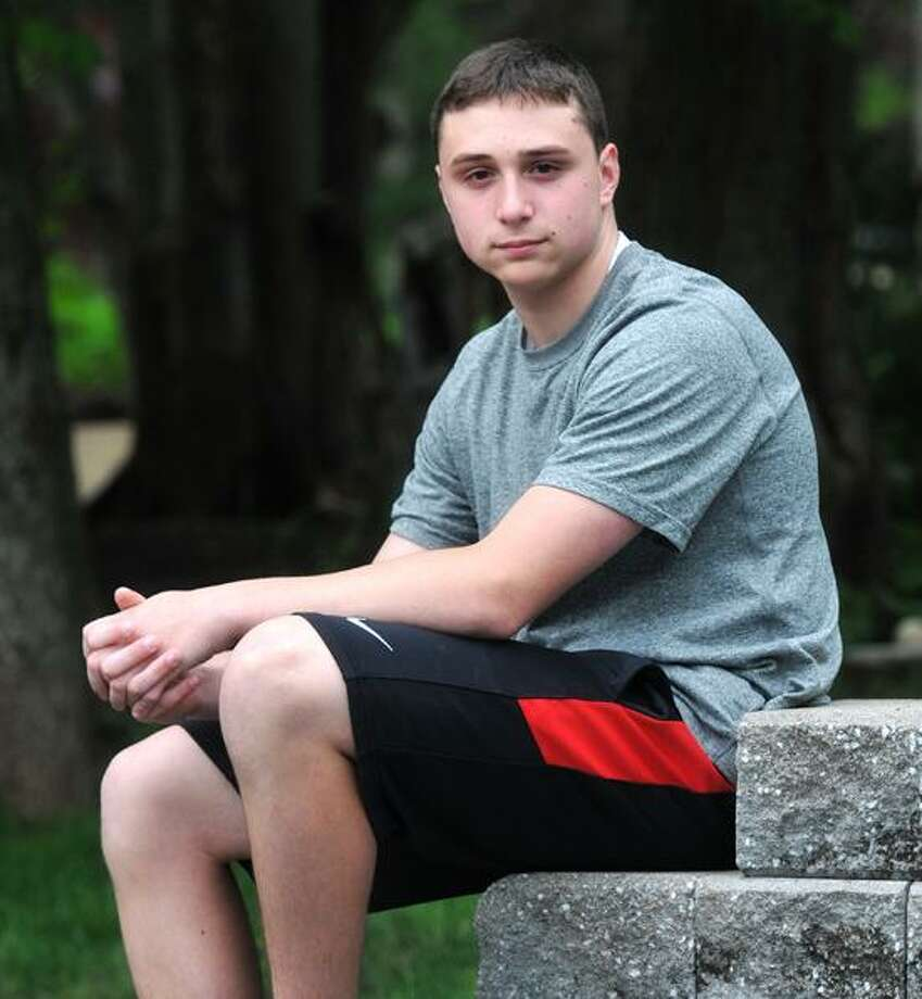 Cheshire--14-Year-old Zach Dubois of Cheshire helped save a man in his neighborhood who had badly injured himself with a chainsaw after he apparently fell off a stepladder. The man was unconscious when Dubois found him.  Peter Casolino/New Haven Register 05/10/12