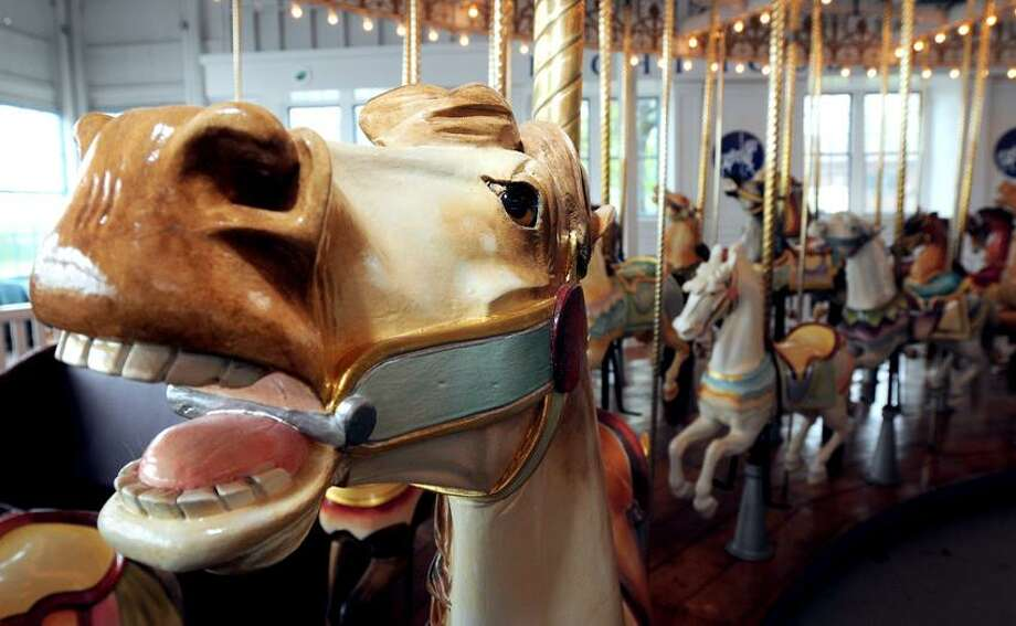 The carousel horse, Fancy Prancy (left), built in 1911 is photographed at Lighthouse Point Park in New Haven on 5/9/2012.Photo by Arnold Gold/New Haven Register   AG0448C