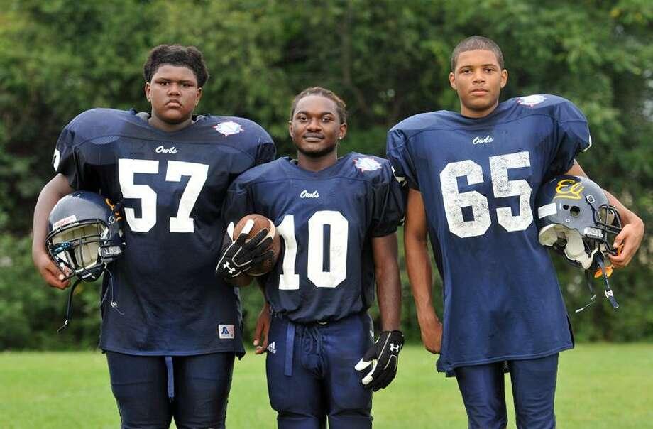 Hamden--Whitney Tech football captains, Pha'Rod Goodman (#57), Anthony Turner (#10) and Elliot Darden (65). Peter Casolino/New Haven Register 9/05/12
