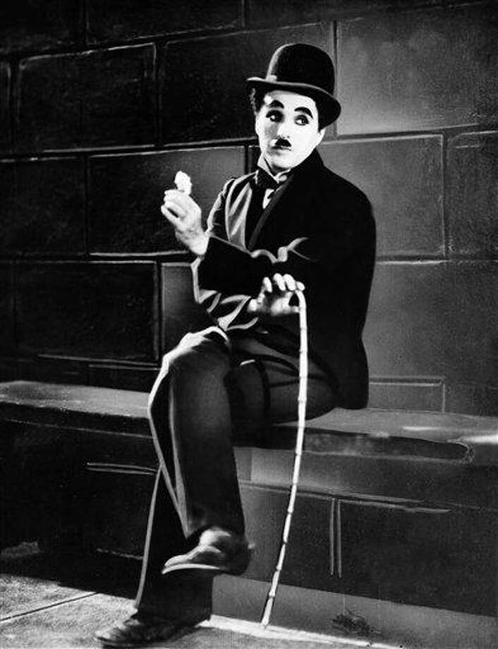 "FILE - In this 1931 film image originally released by United Artists, actor Charlie Chaplin is seen in the silent film ""City Lights.""  A new musical ""Chaplin,"" depicting the life of film icon Charlie Chaplin, will open on Broadway on Monday, Sept. 10, 2012 at the Barrymore Theatre in New York. (AP Photo, file) Photo: AP / 1931 AP"
